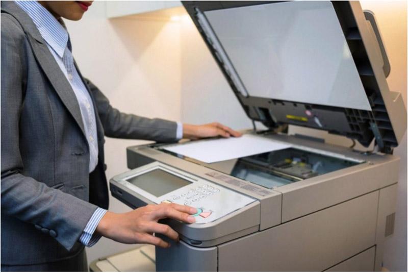 Sử dụng máy photocopy bình thường sau khi reset